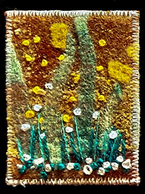 Artist trading card featuring an embroidered garden scene