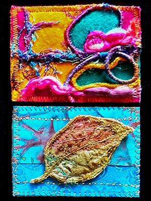 Artist trading cards, one with felting and threads in bright colours, the other a leaf on blue background