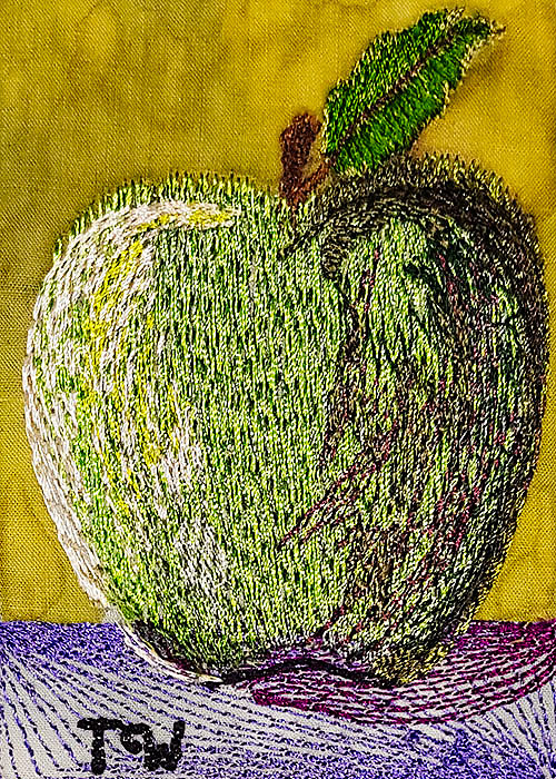 Machine embroidered artist trading card featuring an apple
